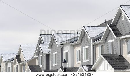 Panorama Frame Facade Of Townhouses In South Jordan Utah With Snowy Gable Roofs In Winter