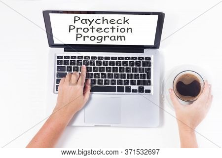 Someones Sitting Om Chair And Using Laptop, Paycheck Protection Program Concept