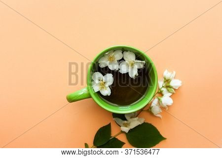 Green Cup Of Tea With Jasmine. Summertimes. Teatime. High Quality Photo