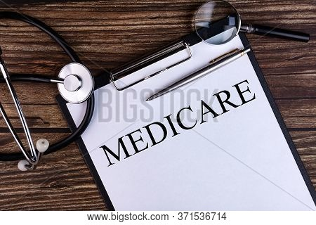Medicare Text Written In A Notebook Lying On A Desk And A Stethoscope. Medical Concept.