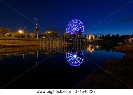 Russia, Irkutsk - June 13, 2020: Colorfull Abstract Ferris Wheel With Reflection On The Konny Island