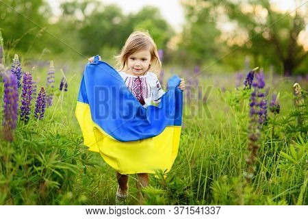 Girl In Traditional Embroidery With Flag Of Ukraine