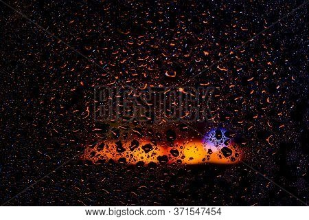 Drops Of Water On A Wet Glass On Light Warm Background
