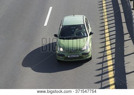 Citroen Green Passenger Car On The Motorway Ring Road. A Young Man Is Driving. Minsk, Belarus. 06/05