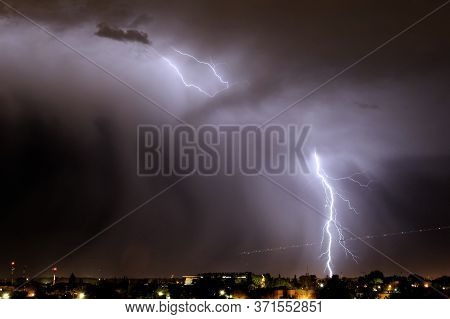 Lightning Strikes At Night During A Severe Thunderstorm Over The City Of Mendoza, Argentina