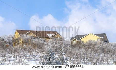 Panorama Pristine Terrain Of Wasatch Mountains With Homes Amidst Fresh Snow In Winter