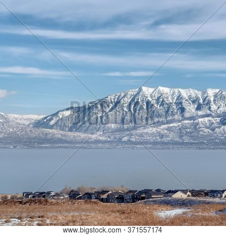 Square Picturesque Wasatch Mountains And Utah Lake Under Cloudy Blue Sky In Winter