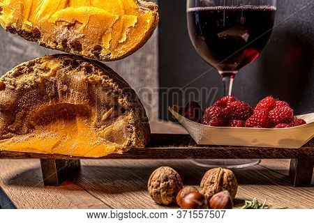 Cheese Gourmet Mimolette With Glass Of Wine, Nuts, Raspberry. Healthy Food Background. Healthy Fresh