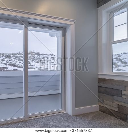 Square View Through Glass Balcony Doors Of Snow In Winter