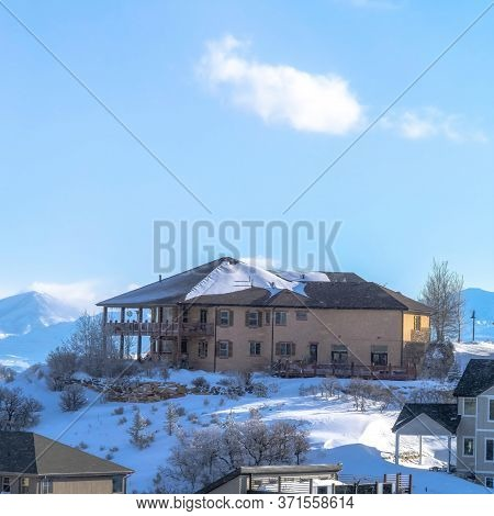 Square Frame Homes On Snowy Terrain With Panoramic Views Of Wasatch Mountain And Valley