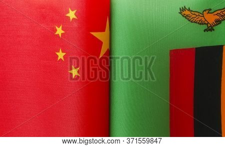 Fragments Of The National Flags Of China And The Republic Of Zambia Close Up