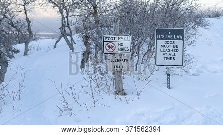Panorama Frame Foot Path And Signages At The Snow Covered Slope Of Wasatch Mountains In Winter