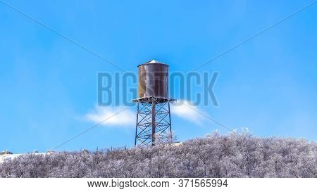 Panorama Cylindrical Water Storage Tank Container On A Steel Tower At Wasatch Mountains