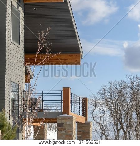 Square Home With Wood And Stone Wall And Balcony With Wasatch Mountain Terrain View