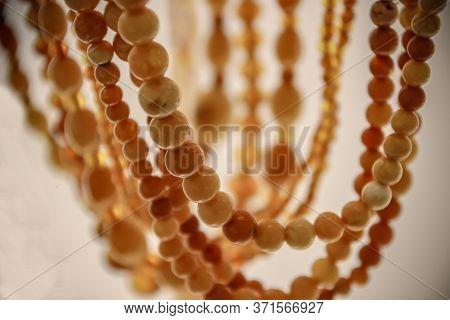 Fragments Of Amber Close-up. Natural Amber Beads.