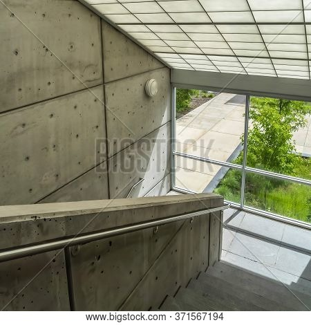 Square Crop Commercial Building Interior With Slanted Frosted Glass Roof Over Staircase