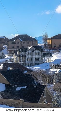 Vertical Crop Pristine Wasatch Mountain Landscape With Houses On Sweeping Snowy Terrain