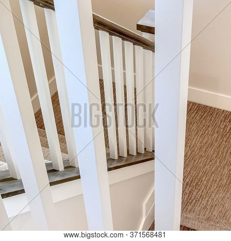 Square Crop White Wooden Baluster And Brown Handrail Of U Shaped Staircase Inside A Home