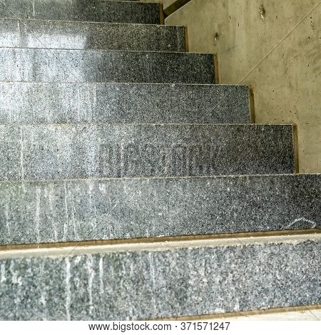 Square Frame Close Up Of Concrete Treads Of A Staircase Inside A Commercial Building