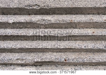 Old Concrete Embossed Wall With Bumps. Gray Abstract Background