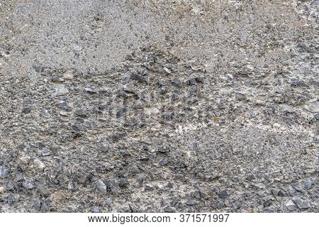 Old Concrete Destroyed Wall With Bumps And Cracks. Gray Abstract Background