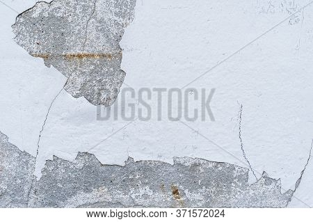 Concrete Wall With Cracked Gray Stucco. Abstract Gray Background
