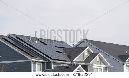 Panorama Frame House Exterior In South Jordan Utah With View Of Solar Panels On The Gray Roof