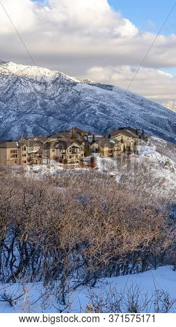 Vertical Crop Wasatch Mountain Homes That Takes In The Unspoiled Snowy Nature Views In Winter
