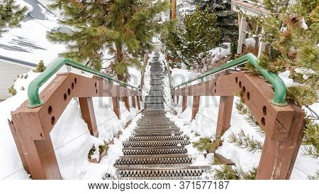Panorama Stairway On Hill Overlooking Rooftops Homes And Trees With Fresh Snow In Winter