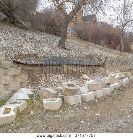 Square Neighborhood Scenery With View Of Collapsed Retaining Wall Made Of Stone Blocks