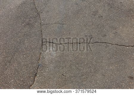 Very Bad Paved Road. Cracks In The Pavement, Potholes. Very Poor Condition Of Local Asphalt Road Aft