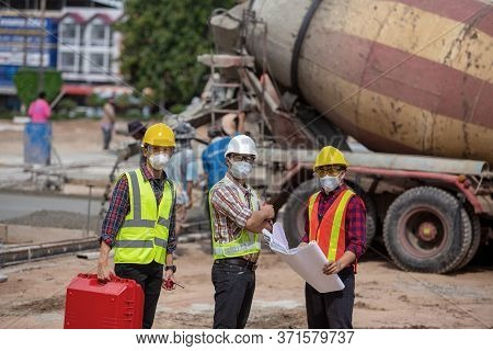 Engineering Team On The Construction Site Outdoor