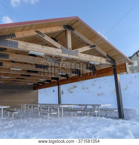 Square Wooden Pavilion Attached To A Building At A Neighborhood In Wasatch Mountain