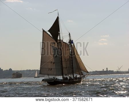Two Masted Sailing Ship On The River