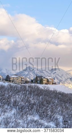 Vertical Crop Picturesque Wasatch Mountains View With Houses On A Snowy Setting In Winter