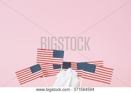 Man waving American flag. Figure of human holding usa banner. Many flags from toothpicks around. Concept social movement, demonstration against the discrimination of society. Rights and tolerance.