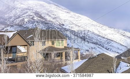 Panorama Beautiful Mountain Homes And Snow Covered Slope Of Wasatch Mountains In Winter