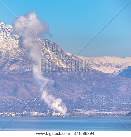 Square Crop Plume Of White Smoke Rising From A Fire