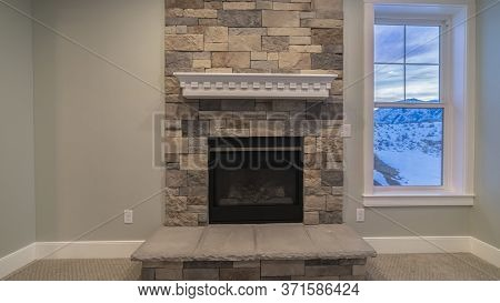 Panorama Frame Fire Insert In A Feature Stone Brick Wall