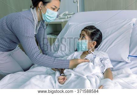 Nursing Kid In Flu Sickness Pandemic Corona Virus Situation Is Most Danger Photo Concept. Parent Che