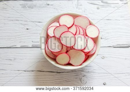 Closeup Radish Slices In The Bowl. Raw Organic Radish Chips Slices Ready To Eat.
