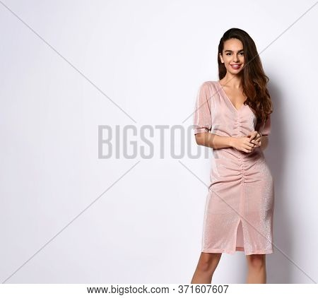 Young Romantic Girl With Bright Smile Posing In Stylish Powder-pink Short Straight-cut Dress. Style