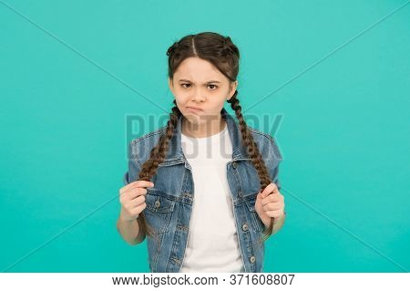 Look Of Discontent. Unhappy Girl With Braided Hairstyle. Beauty Look Of Little Child. Casual Fashion