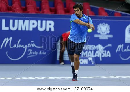 KUALA LUMPUR - SEP 23: Treat C. Huey (Phi) plays in the qualifying match of the ATP Tour Malaysian Open 2012 on September 23, 2012 at the Putra Stadium, Kuala Lumpur, Malaysia. He lost to R. Ghedin.