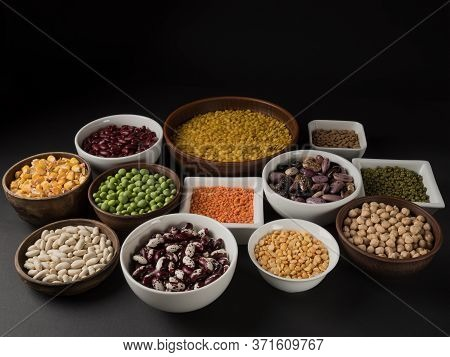 Organic Legumes. Black Background. Different Varieties Of Peas, Beans And Lentils.