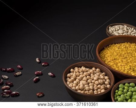 Beans In A Clay Pot On A Black Background.