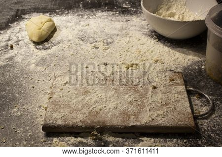 Wheat Flour On Cutting Boart Left After Cooking Dough Or Pastry.