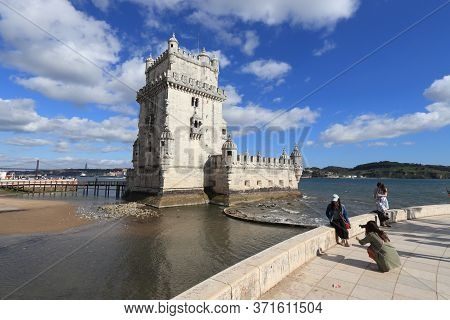 Lisbon, Portugal - June 5, 2018: People Visit Torre De Belem Fortification On Tagus River In Lisbon,
