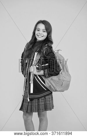 English Style Fashion. Small Girl Uniform Hold Backpack. Kid With English Flag On Jacket. Go Study T