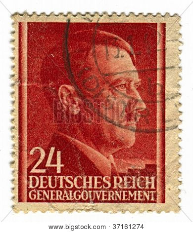 GERMANY - CIRCA 1943: A stamp printed in Germany shows image of Adolf Hitler was an Austrian-born German politician and the leader of the Nazi Party, in red, circa 1943.
